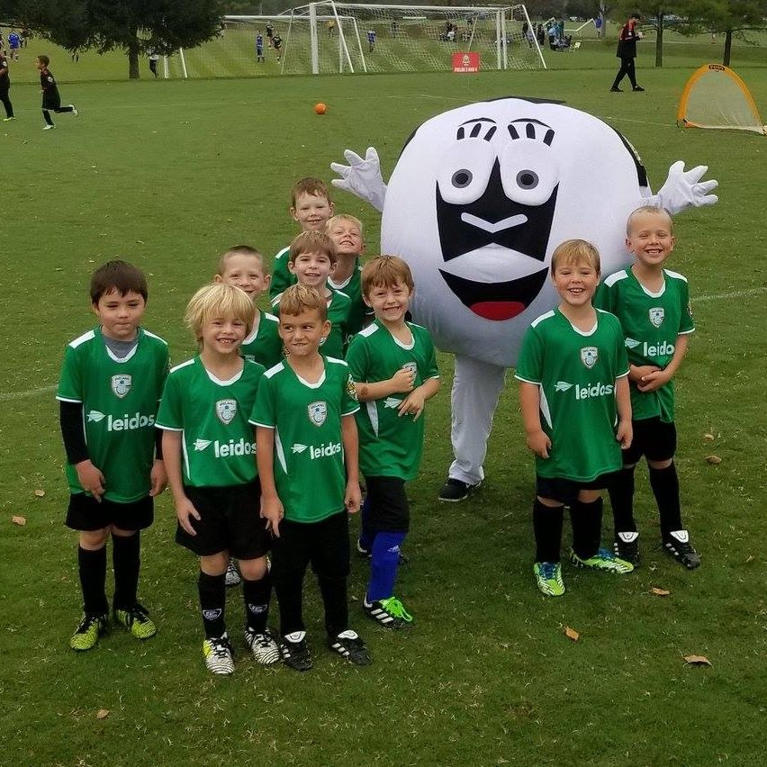 "alt=""Boys recreational Ireland team with Sammy the soccer ball"""